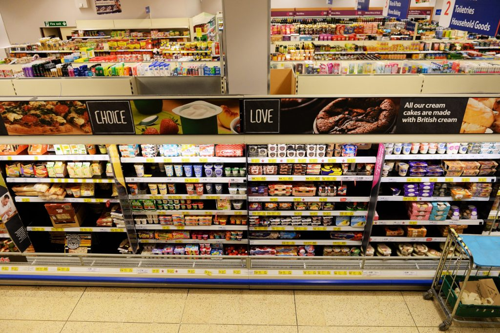 LONDON - JAN 28 Shelf aisle view at a Tesco store on Jan 28, 2015 in London, UK. Britain Tesco is the world third largest supermarket retail chain after America Walmart and France Carrefour